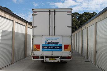 Jackson Removals' truck parked in storage complex